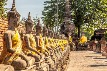 Alley of Buddha statues at the temple in Thailand