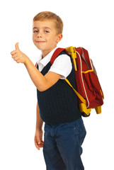 Schoolchild giving thumb up