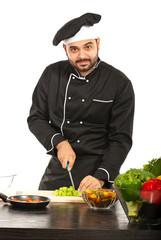 Cheerful chef working in kitchen