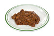 Chipped barbecue pork in thick gravy on a plate