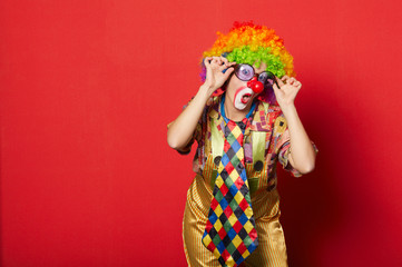 funny clown with glasses on red backround