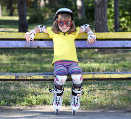 little girl with sunglasses and roller skates