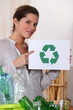 Woman recycling glass and plastic bottles