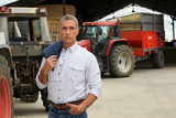 Farmer stood in front of tractors