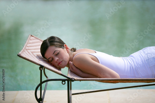 Woman asleep by a pool
