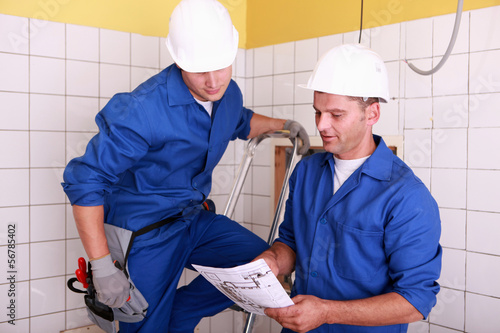 Electricians working together