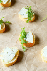 canape with blue cheese and fresh rocket