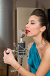 Beautiful woman with red lips sing in room with microphone