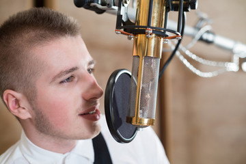 Man singing with microphone in Recording Studio