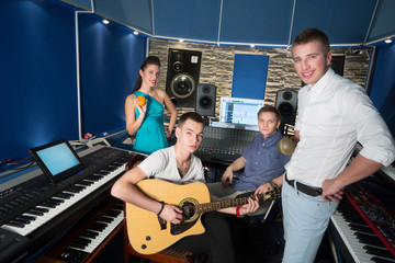 Young musicians with musical instruments in Studio