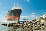 Cargo ship run aground on rocky shore