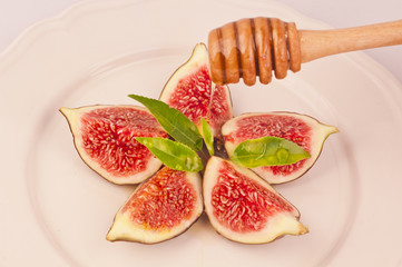 Plate of delicious figs and dripping honey