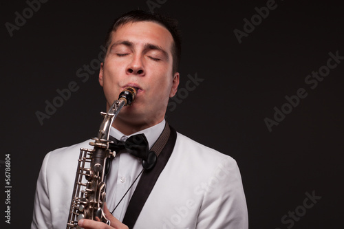 Closeup of playing saxophonist. Modern musician