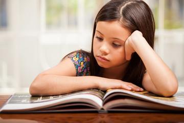 Little girl focused on reading