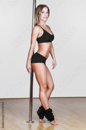 Sexy pole dancer posing
