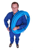 Plumber with coil of piping