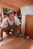 plumber under a sink