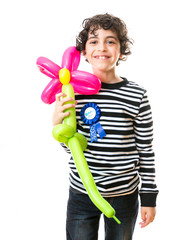 Child Holding a Balloon Flower