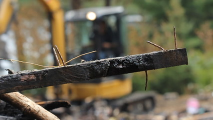 Burnt wood and nails. Shallow DOF. Housefire cleanup.