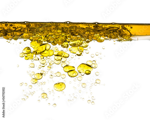 canvas print picture oil splash in water isolated on white background