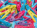 Close up of multicoloured plastic clothes pegs.