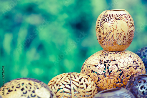 Foto op Plexiglas Indonesië many lamps carved from a coconut tree, bali, indonesia