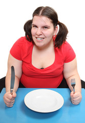 Hungry obese woman with empty plate.