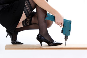 Stockinged woman with a drill
