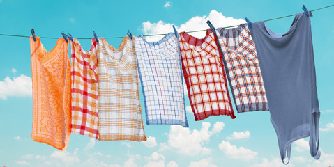 Laundry hanging over clear blue sky