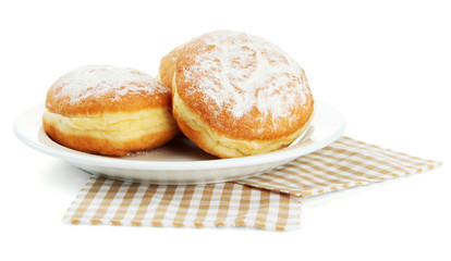 Tasty donuts on plate, isolated on white