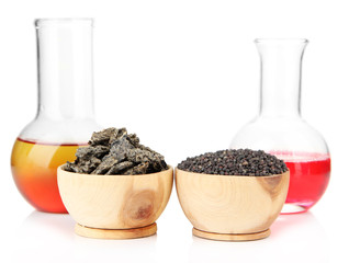 Beakers with bio fuel from rape seeds, oil cakes, isolated