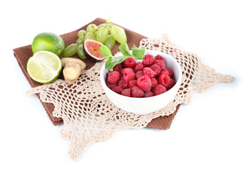 Raspberries in small bowl on napkin isolated on white
