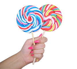 Woman hand golding two lollipops