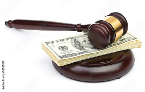 Law gavel on a stack of American money. - 56799831
