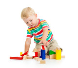 Fototapety kid boy playing  wooden toys