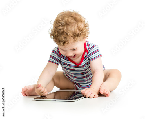 baby boy playing with digital tablet isolated on white