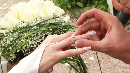 Bride and groom exchanging rings on the wedding ceremony