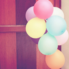 Multicolored balloons hanging on door