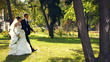 Bride and groom on a walk in a park
