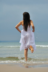 lonely woman running to sea in cloudy and rainy day
