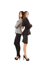 Attractive businesswomen with arms folded