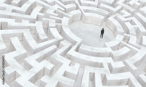 businessman in the middle of a maze - 56806043