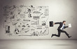 business strategy on a wall and running businessman