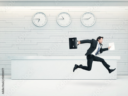 office interior with running businessman