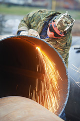 Welder worker with flame torch cutter