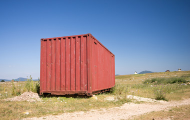 Shipping container places in field
