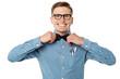 Nerd guy adjusting his bow tie