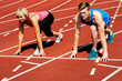 Athletes at starting line on race track
