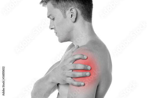 Guy holding his shoulder in pain