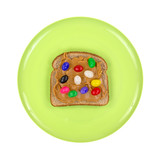 Green plate with a peanut butter and jelly beans on wheat bread